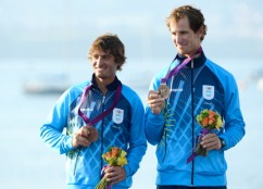 Argentina's Lucas Calabrese (L) and Juan de la Fuente (R) celebrate on the podium after winning bronze in the men's sailing 470 two person dinghy medal race at the London 2012 Olympic Games in Weymouth on August 10, 2012. AFP PHOTO / William WEST (Photo credit should read WILLIAM WEST/AFP/GettyImages)